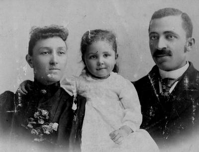 family-portrait-of-man-woman-and-small-child