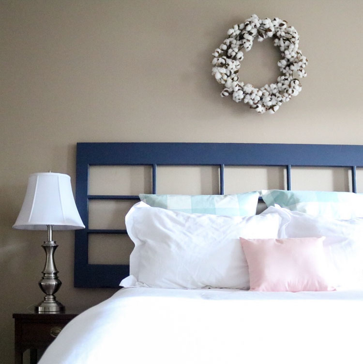 Master bedroom refresh: old French door headboard | Homespun by Laura | DIY pillow made from spare armrest covers