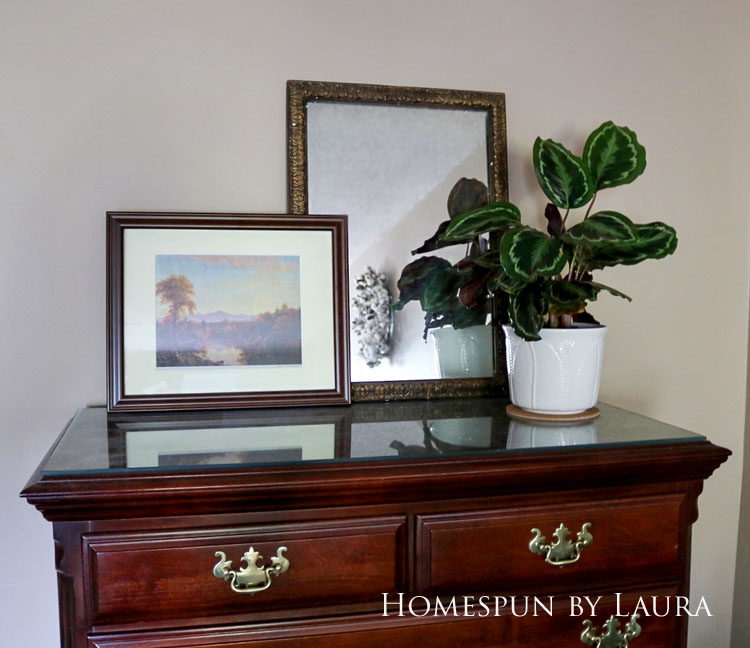 Master bedroom refresh | Homespun by Laura | Dresser with decor - plant, art, and mirror