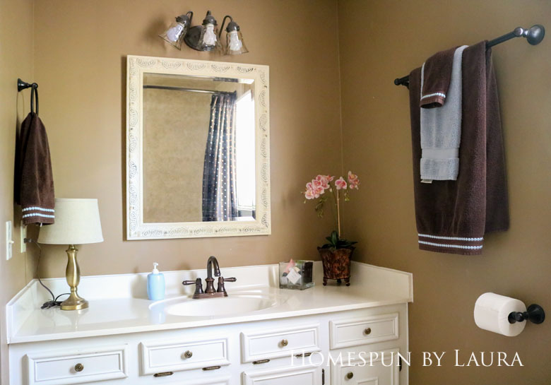 $75 DIY Powder Room (and Pantry!) Update: One Room Challenge Week 3 | Homespun by Laura | How to make a DIY framed mirror for under $15 in a few hours without any power tools!