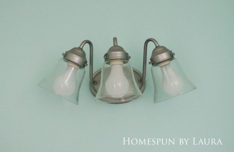 The $200 Master Bathroom Refresh | Homespun by Laura | Easy and inexpensive DIY updated light fixture with spray paint and new globe covers for under $20.