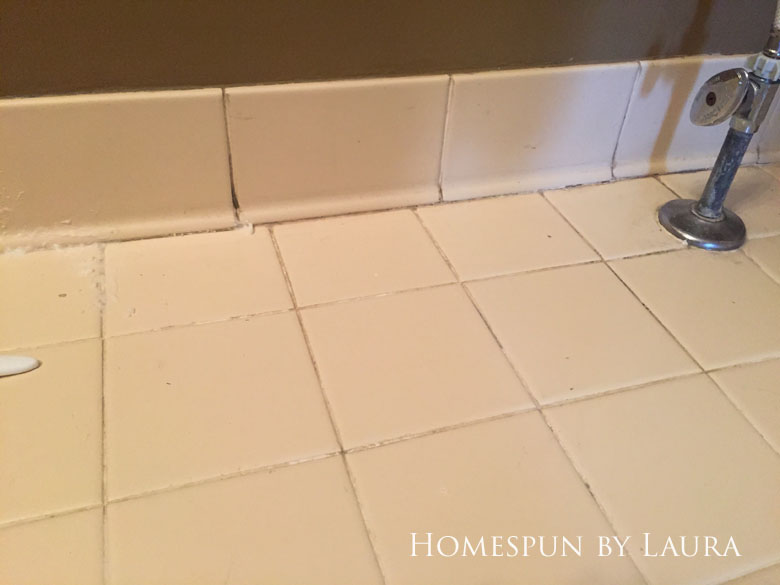 Cleaning the floor grout with bleach pen and bleach + baking soda paste wasn't fun but was worth it (before)