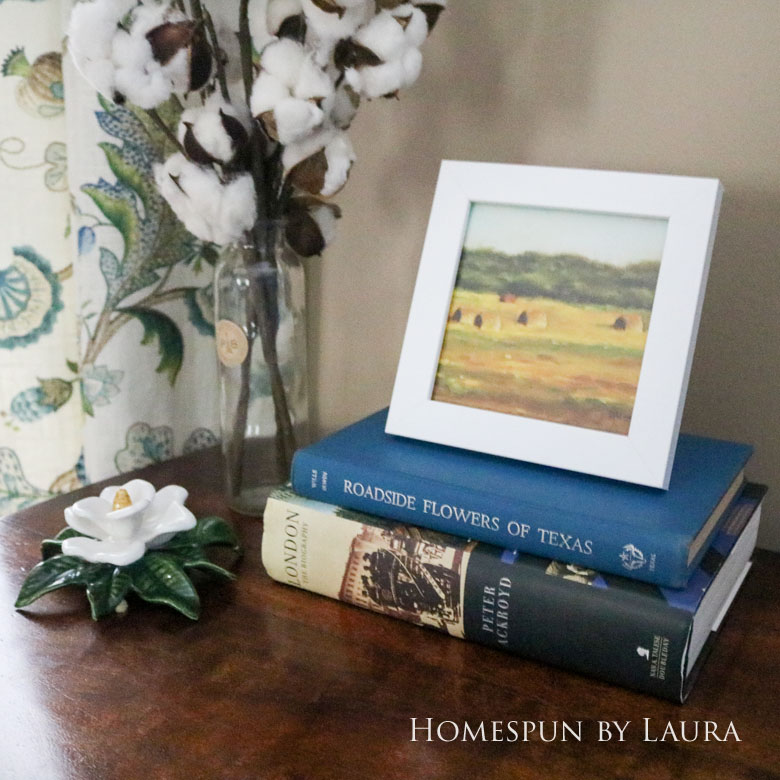 Cleaned up antique brass hardware, cotton stems, and hardback books dress up a boring desk in the den | Homespun by Laura
