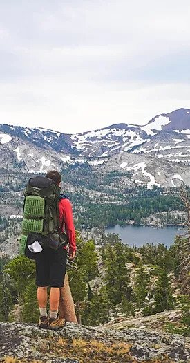 OWAA hiker looks out at mountain vista