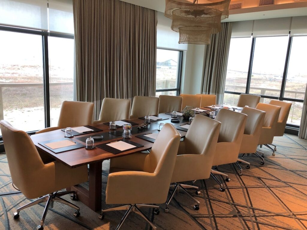 Chairs arranged around a table in a boardroom