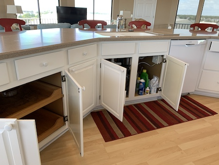 sellers open cupboards and drawers
