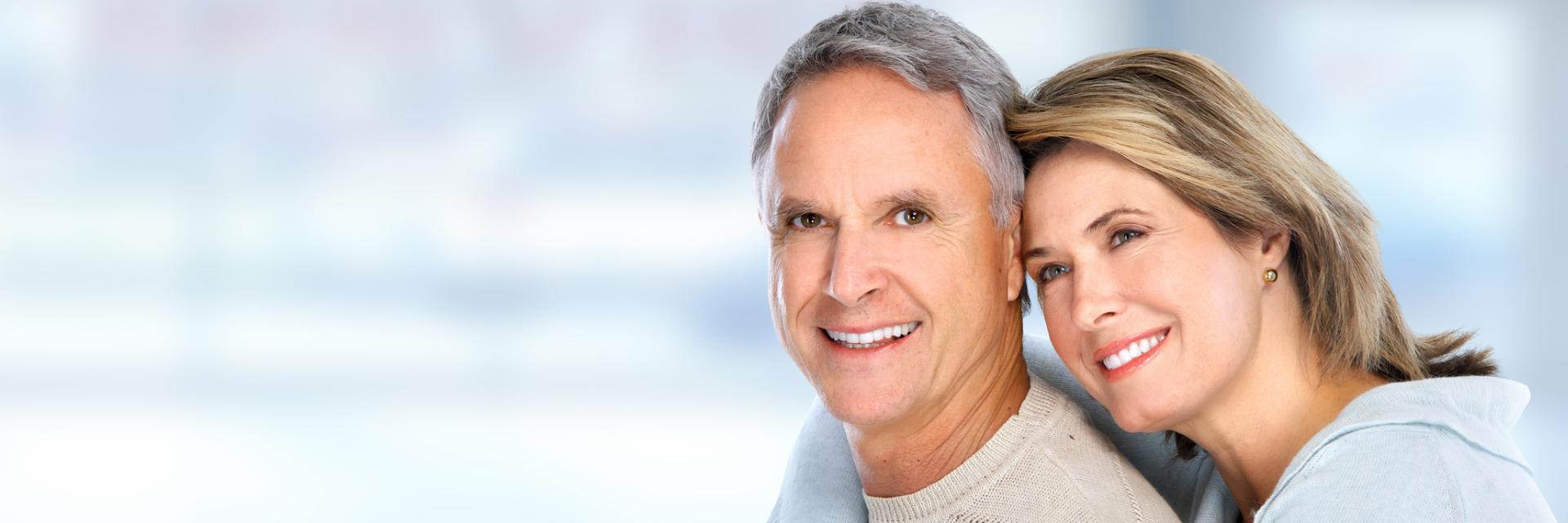 senior couple with healthy teeth