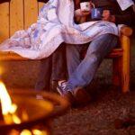 Couple sitting with coffee mugs