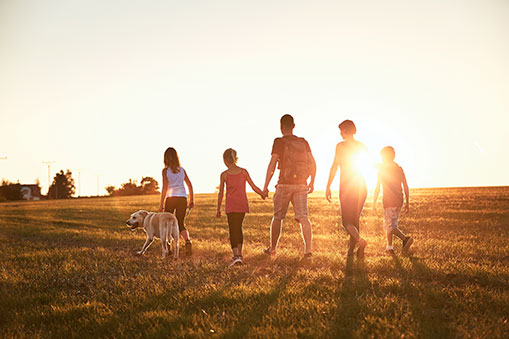 A Family Walking on Field Together