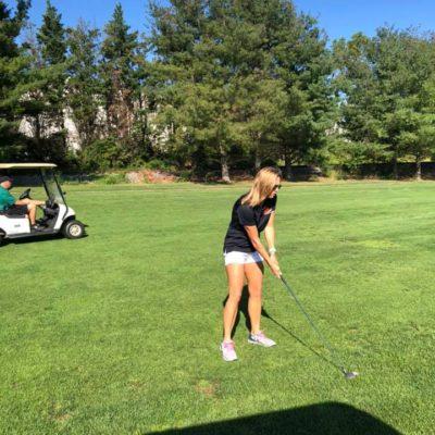 Tammy Lofink of Rising Above Addiction participates in the Sickle Drive Annual Invitational Golf Tournament