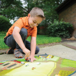A1342X6_PLAY_FarmlandBoyPlayingOutside_LIFE1_HiRes300dpi