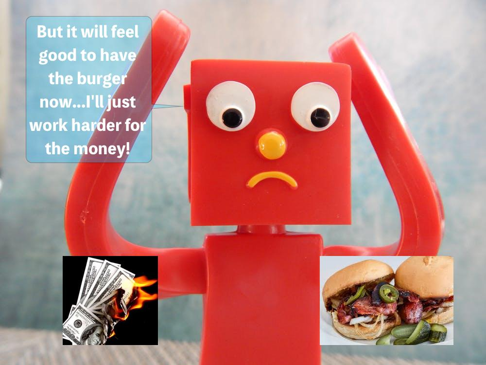 Picture of toy trying to decide between a burger or money that's on fire