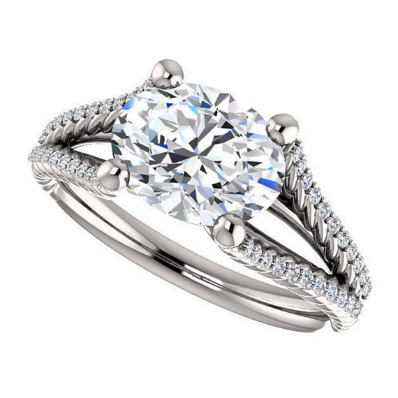 east-west engagement ring with an oval diamond