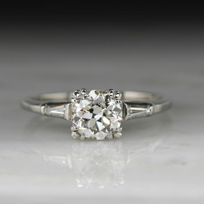 Claw prong solitaire with baguettes