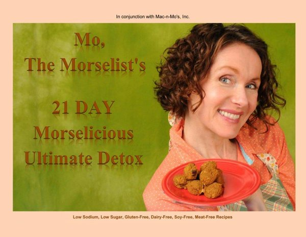 Certified Health Coach, Mo The Morselist, poses in a salmon colored top while smiling a holding up a plate of her morsels. Graphic reads: Mo, the Morselist's 21 Day Morselicious Ultimate Detox. This is the cover of her cookbook.