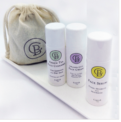 Three Caryl B. Skincare products on a shelf: green tea face cleanser, face cream, face serum.