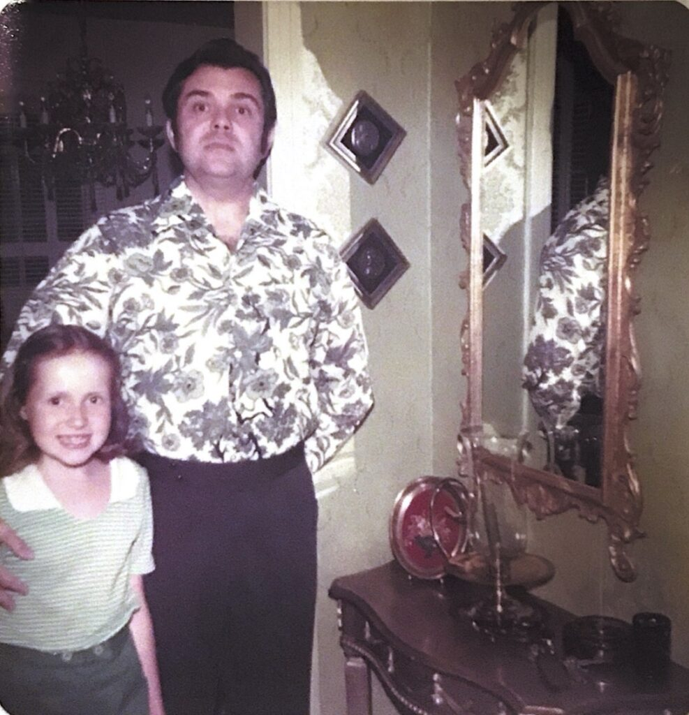 A young Mo with her dad, Mac