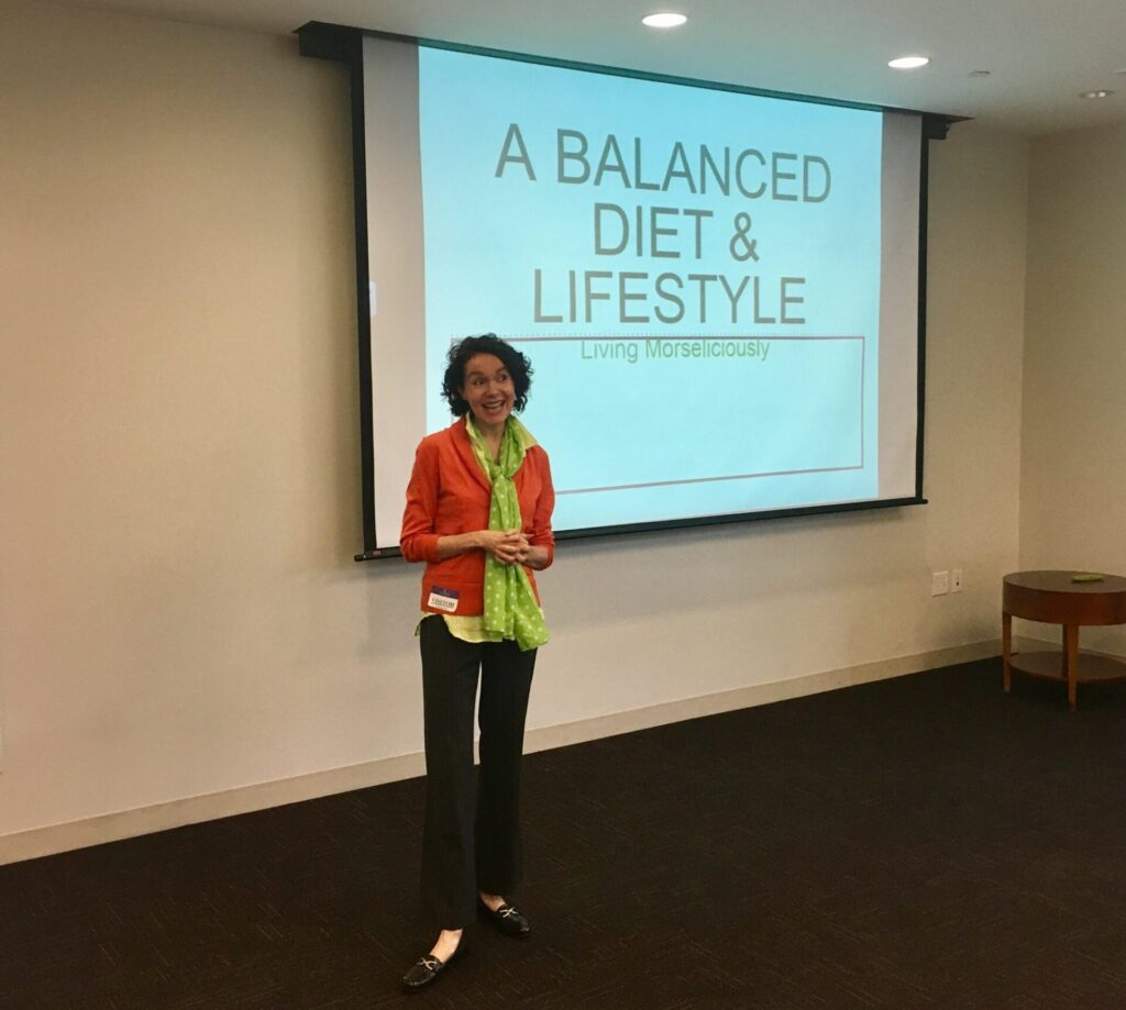 Guest Speaker and Certified Health Coach Mo The Morselist giving a presentation on A Balanced Diet and Lifestyle: Living Morseliciously