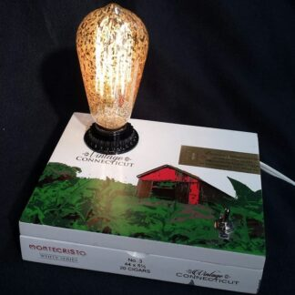 Montecristo cigar box lamp with vintage barn farm on top and a large Edison style bulb. White box with green and red design. A unique farm country gift.SL-431