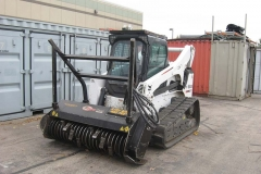 SKID STEER LOADER AND ATTACHMENT