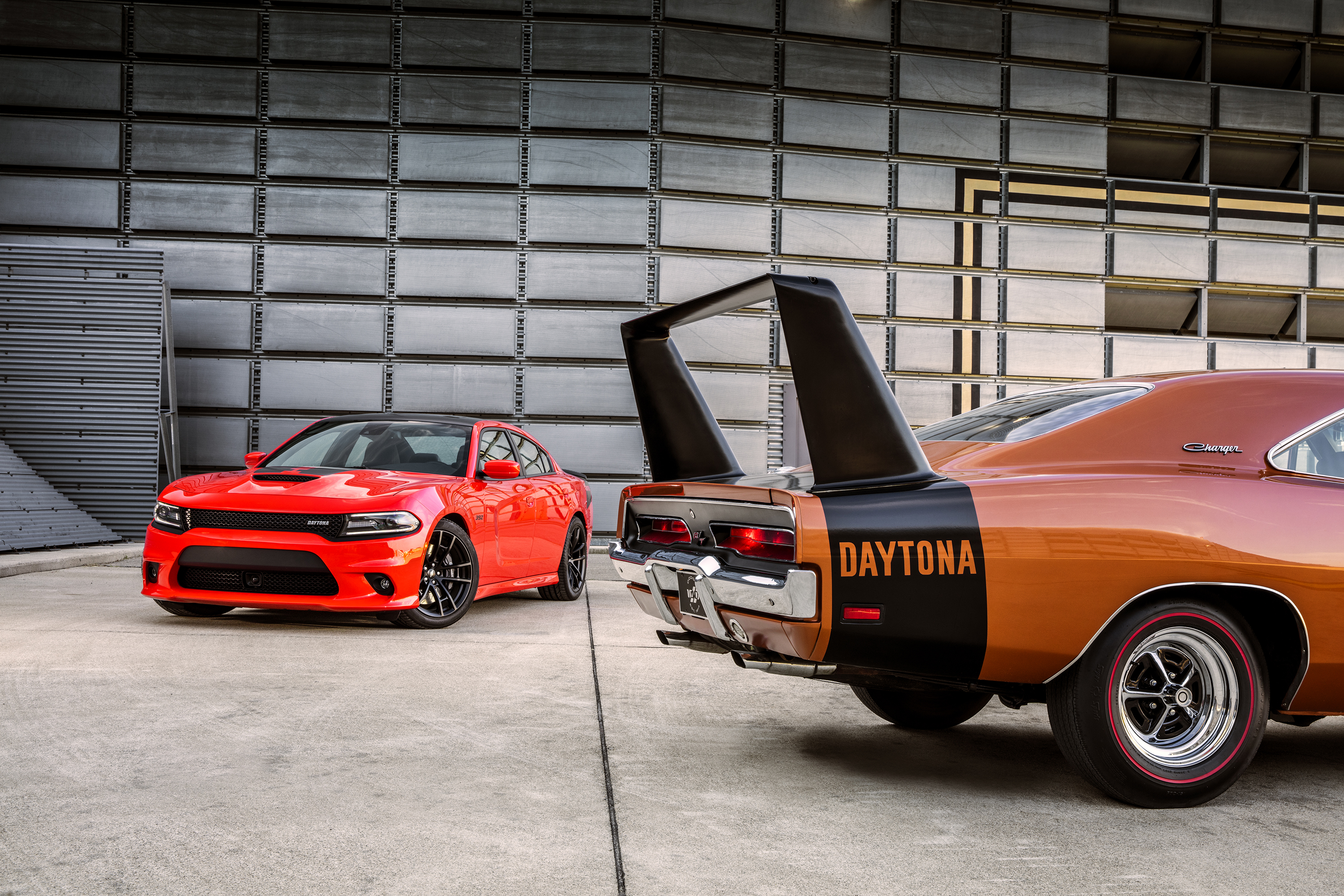 2017 Dodge Charger Daytona 392 (left) and 1969 Dodge Charger Day
