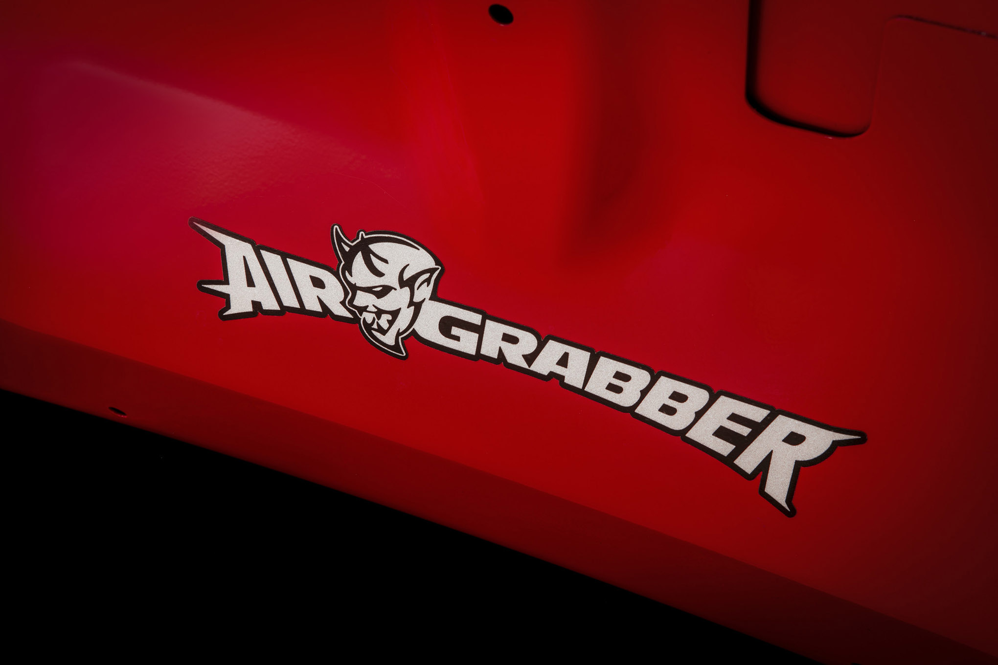 The Air Grabber logo on the underside of the hood of the 2018 Do