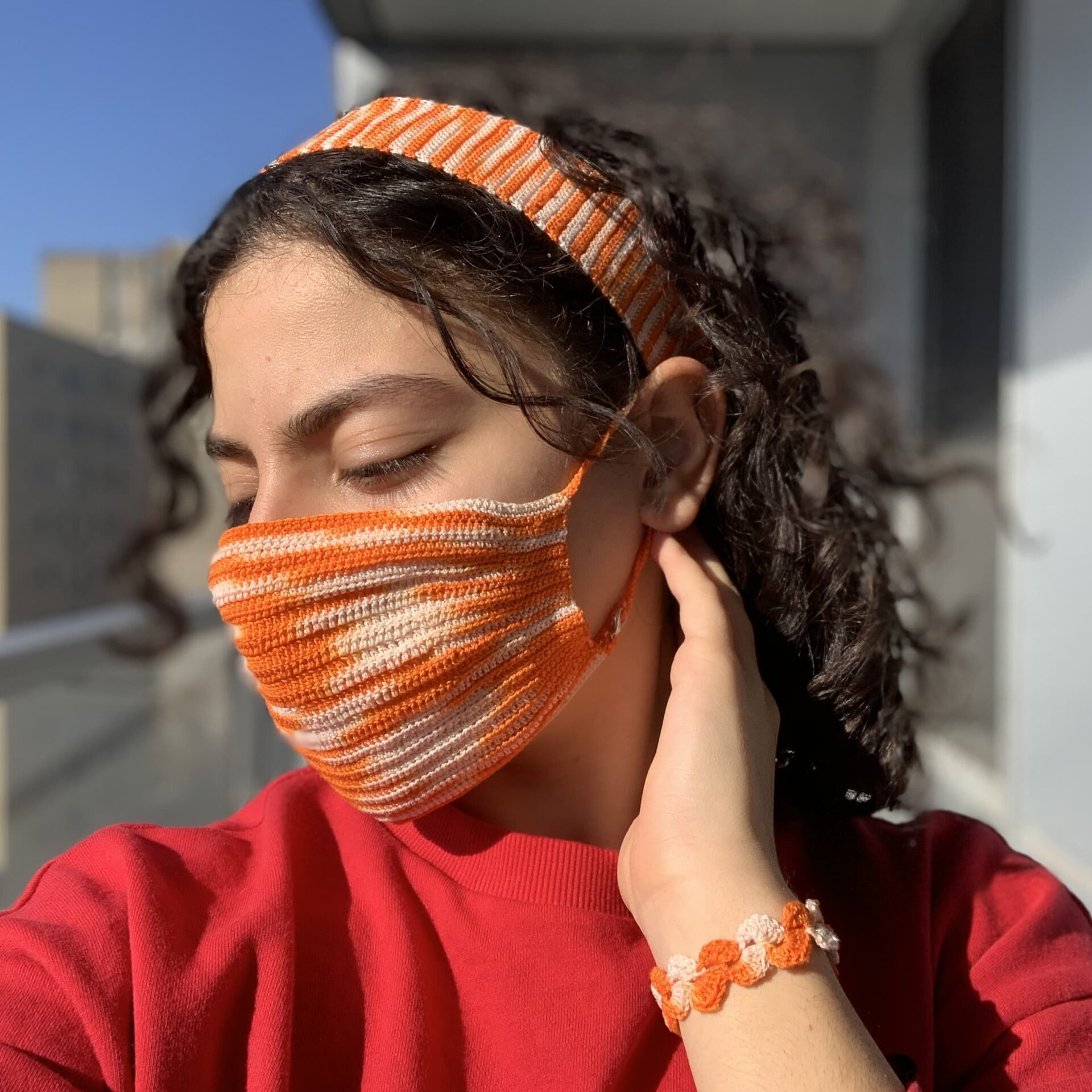 cover an orange cover face -hand made crochet