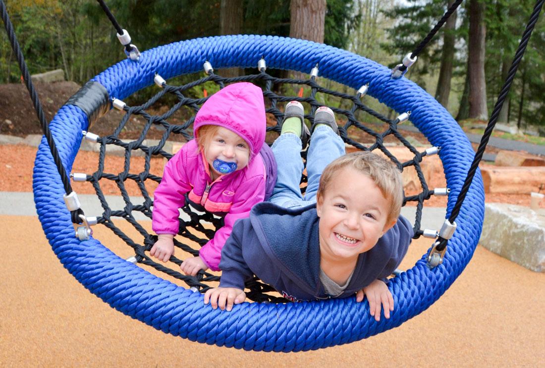 Happy kids on basket swing