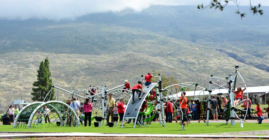 Multiple level play structures for kids of all ages at a park in Hawaii, designed by Highwire
