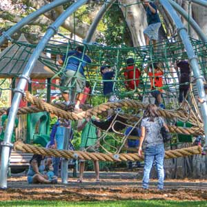 Multi level playground for swinging and playing