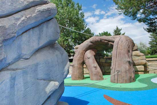 Natural looking stone and wood sculpted climbing structures for commercial playgrounds