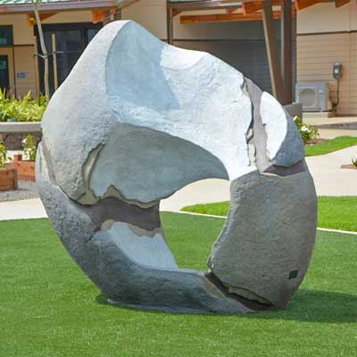 Playground structure designed to be used as a rock climbing structure for commercial playgrounds