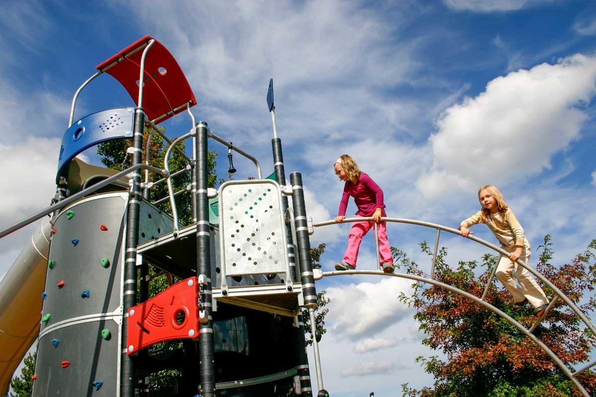 Children playing on modern playground structure