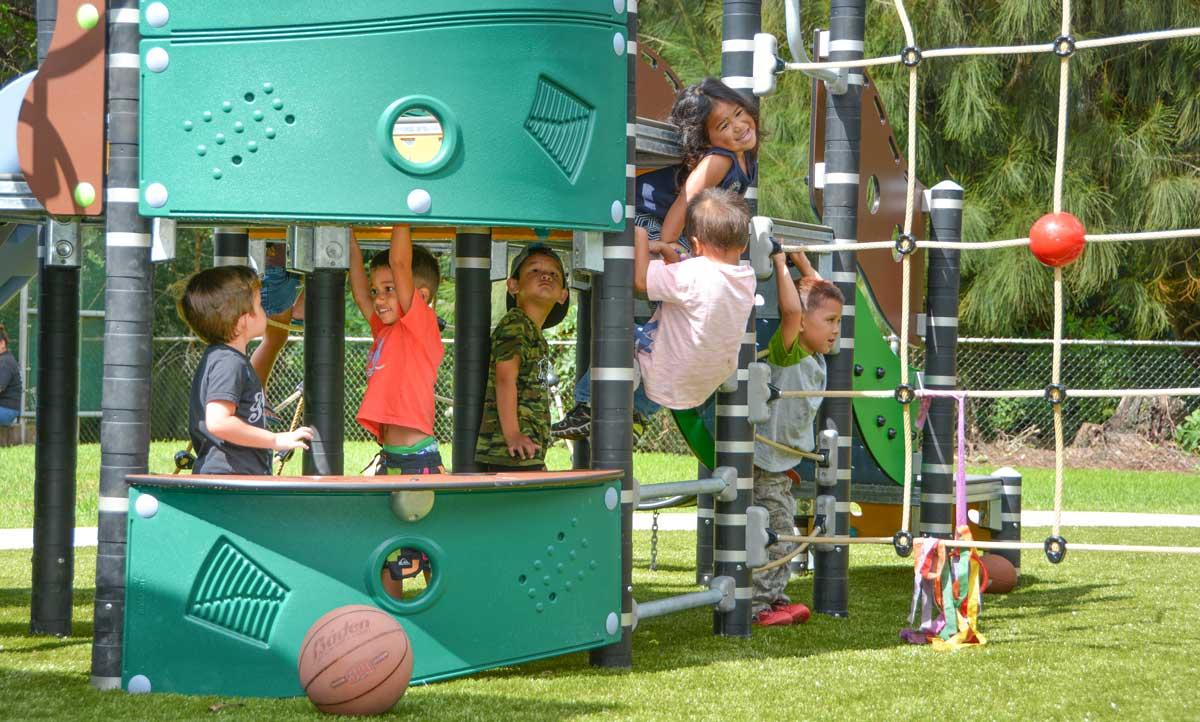 Pretend play and climbing playground equipment