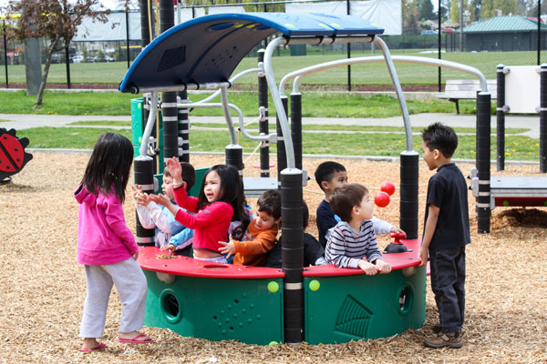 Pretend play structures and playground equipment for daycare centers