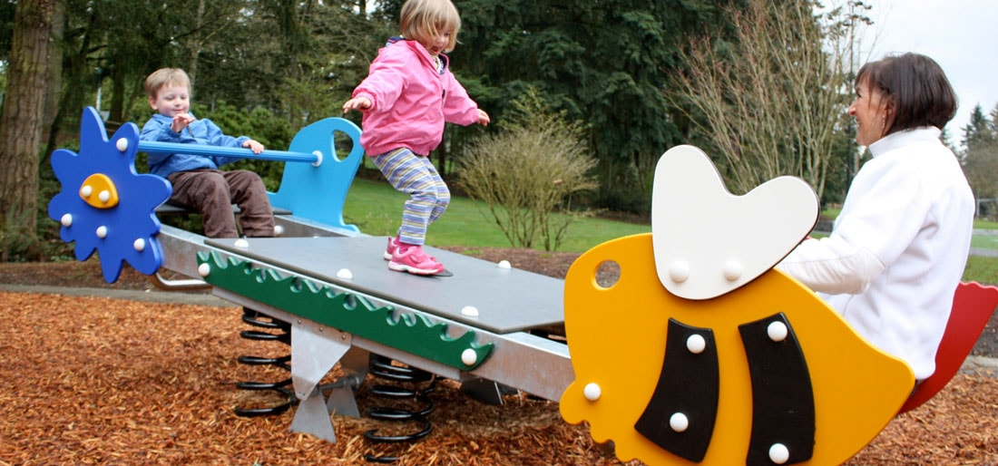 Modern toddler safe fully compliant pre-school park ad playground equipment designed by KOMPAN