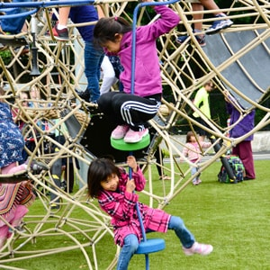 Children enjoying play on KOMPAN play equipment at the Seattle Center Park Play Area