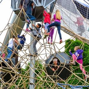 Children enjoying the climbing net at the Seattle Center Play Structure
