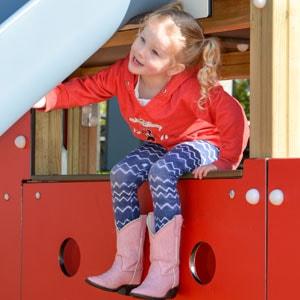 Toddler girl on KOMPAN Playground Equipment
