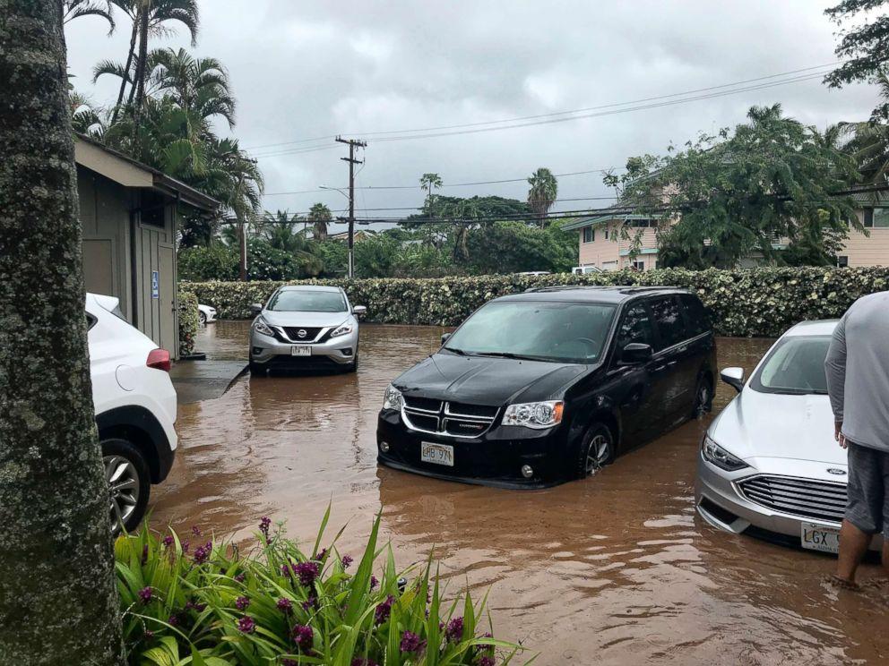 PHOTO: Water floods a parking lot at a condo complex near Kahana Village in Lahaina, Hawaii, Sept. 12, 2018.