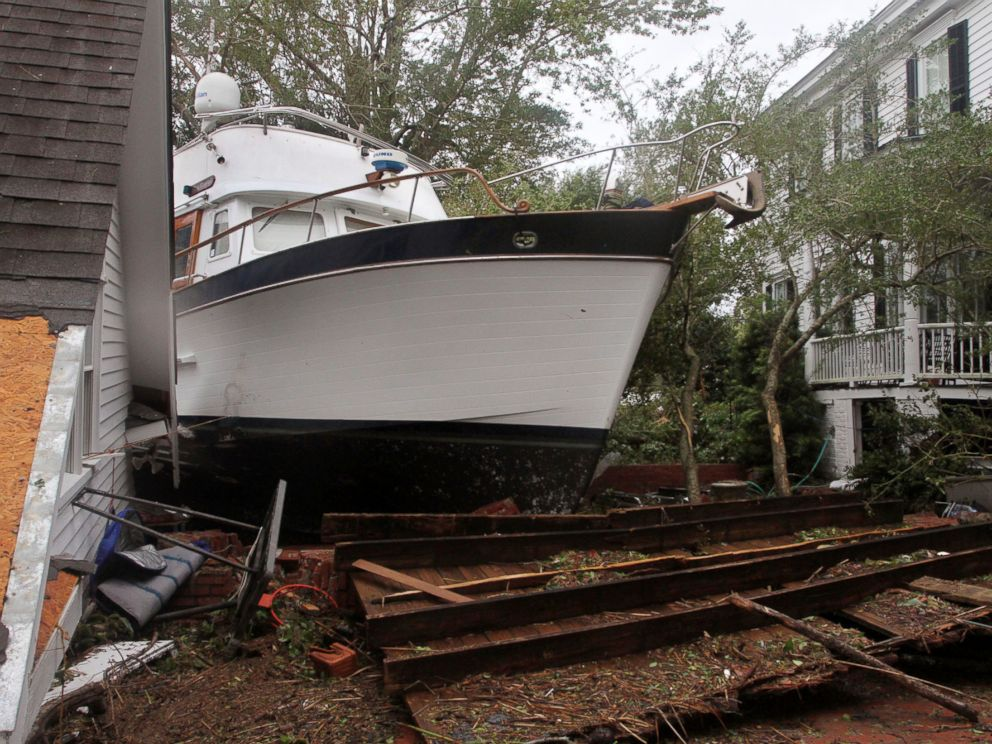 PHOTO: A 40-foot yacht lies in the yard of a storm-damaged home on East Front Street in New Bern, N.C., Saturday, Sept. 15, 2018. The boat washed up with storm surge and debris from Hurricane Florence.