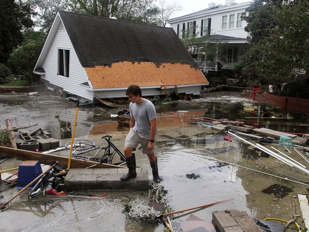 PHOTO: Resident Joseph Eudi looks at flood debris and storm damage from Hurricane Florence at a home on East Front Street in New Bern, N.C., Saturday, Sept. 15, 2018.