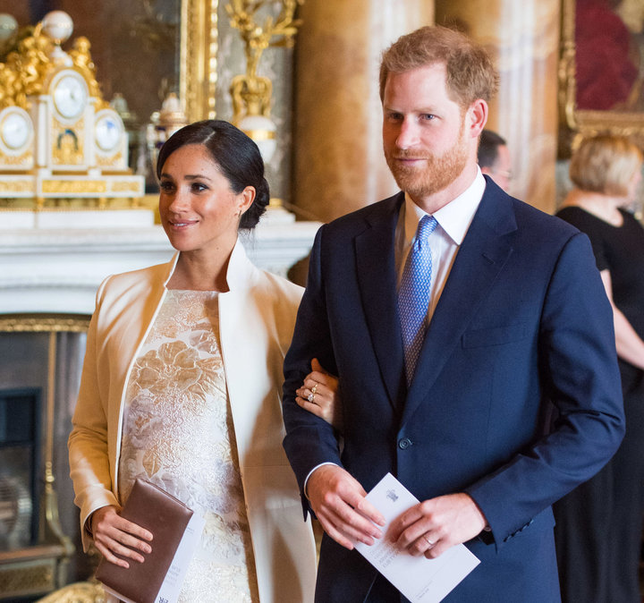 Meghan, Duchess of Sussex, and Prince Harry attend a reception to mark the 50th anniversary of the investiture of the Prince