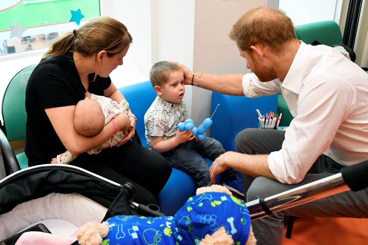 The duke visiting with some of the children at the hospital.