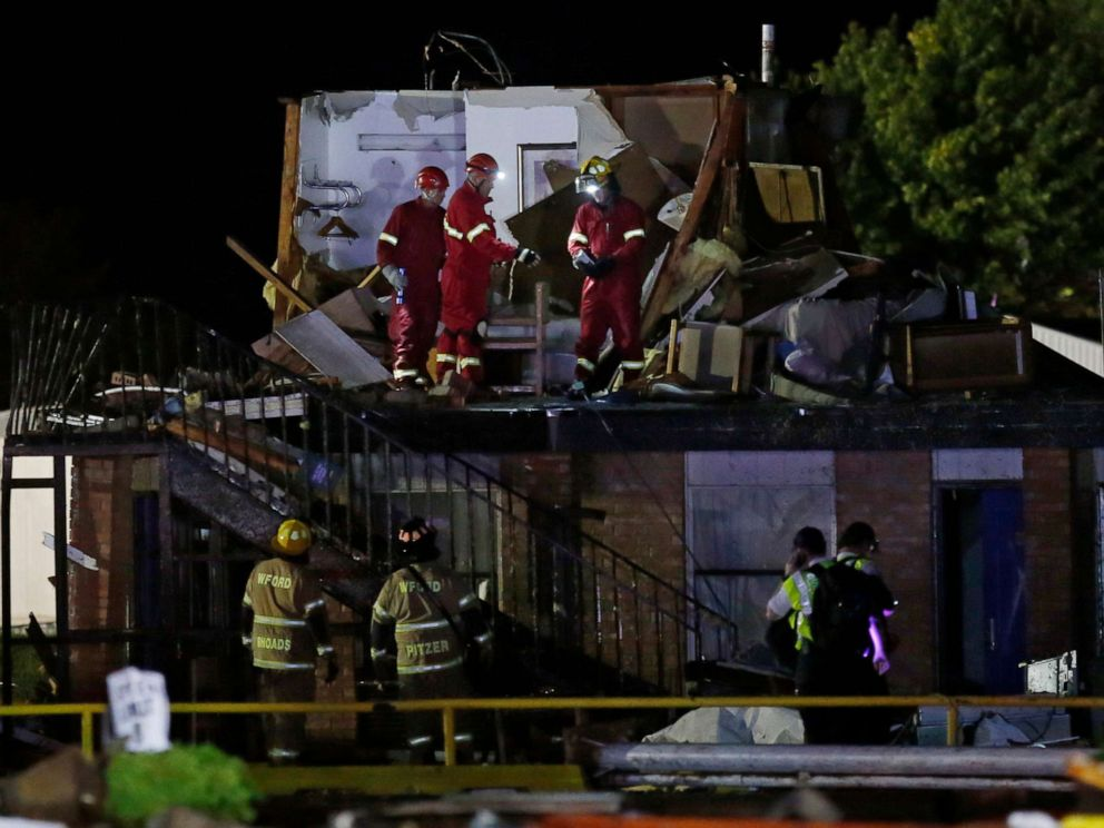 PHOTO: Emergency workers check what is left of the second floor of a hotel, May 26, 2019, in El Reno, Okla., following a tornado.