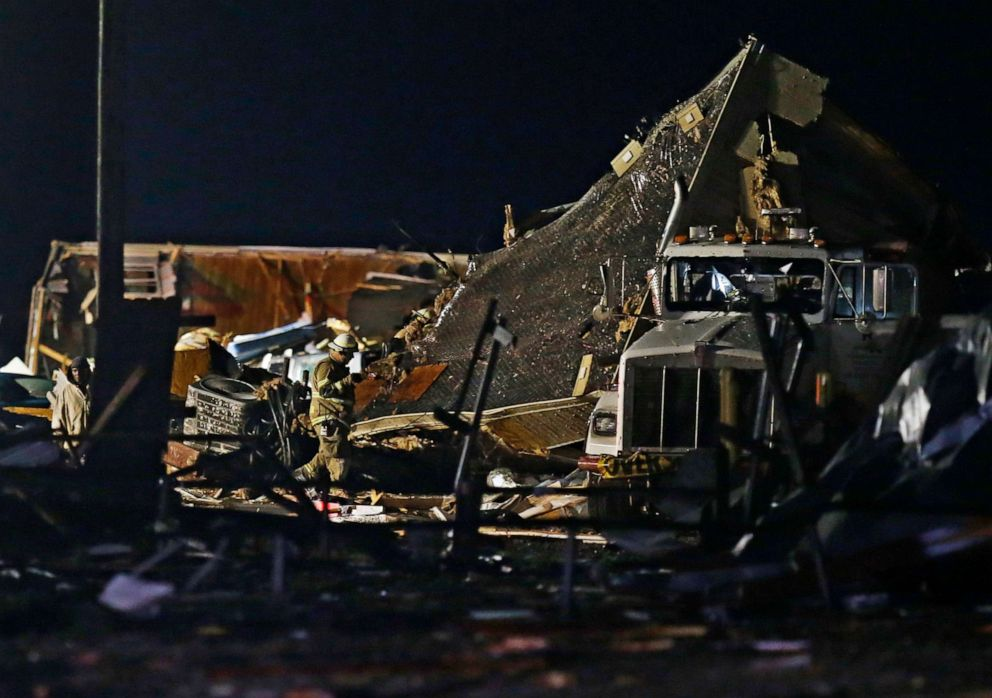 PHOTO: Emergency workers search through debris from a mobile home park, May 26, 2019, in El Reno, Okla., following a tornado.