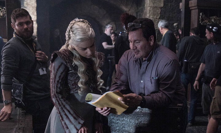 """Emilia Clarke and David Nutter on the set of """"Game of Thrones."""""""
