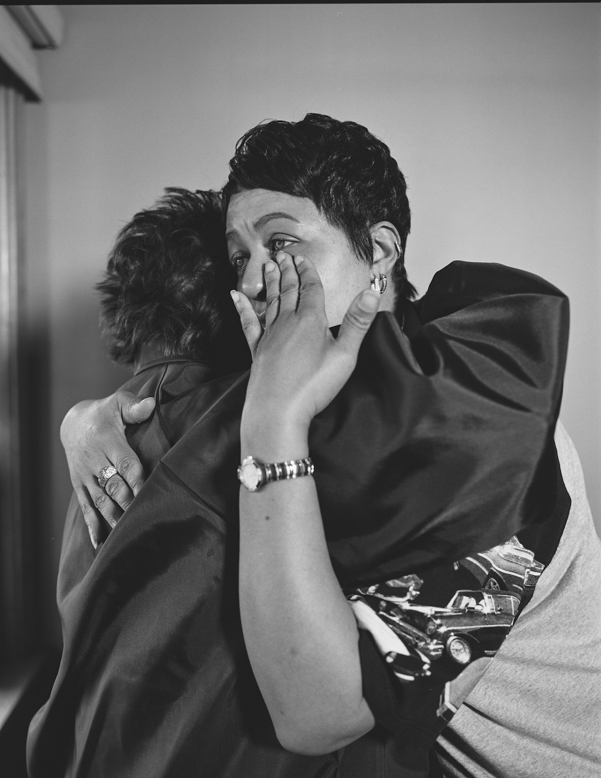LaToya Ruby Frazier, 'Kesha Scales hugging Beverly Williams in her living room (22 years in at GM Lordstown Assembly, pressroom), Youngstown OH,' 2019.