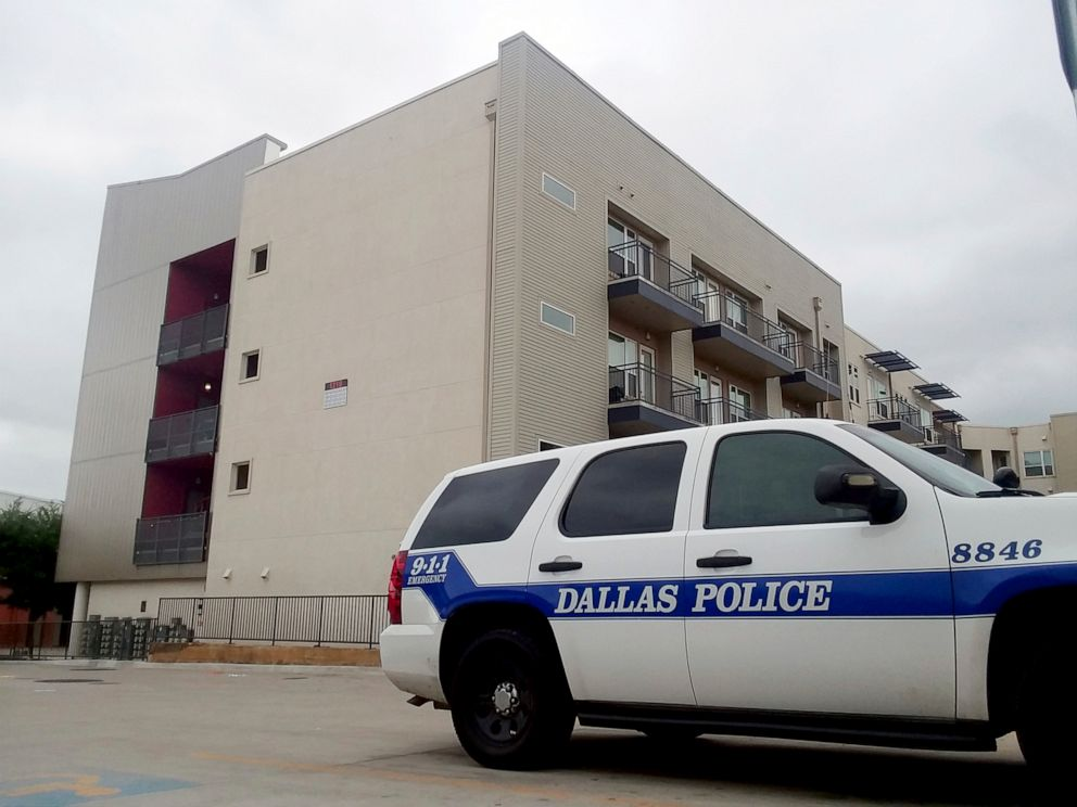 PHOTO: A Dallas Police vehicle is parked near the South Side Flats apartments, Sept. 10 2018, in Dallas.
