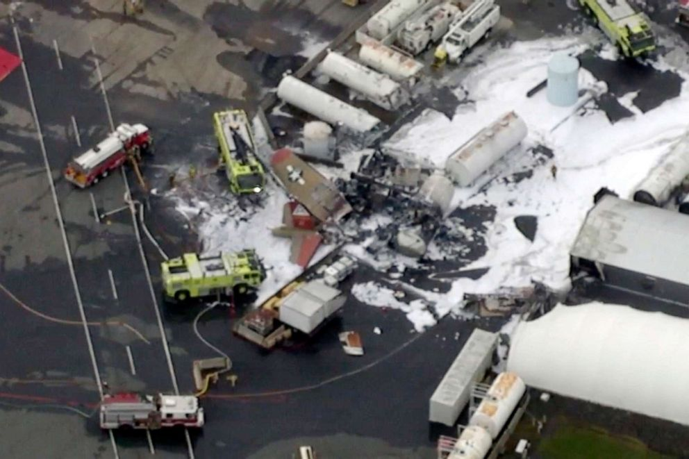 PHOTO: In this aerial image taken from video, emergency crews respond to where a World War II-era bomber B-17 plane crashed at Bradley International Airport in Windsor Locks, Conn., Oct. 2, 2019.